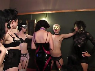 Fetish lovemaking party with a lesbian sub serving lots of upper classes