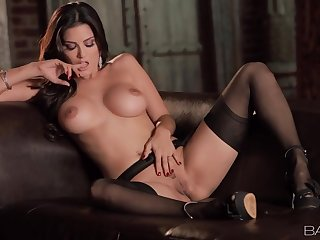 Sunny Leone spreads her legs and masturbates in the matter of stockings