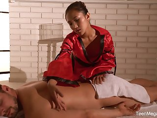 Louring haired Asian masseuse May Thai is poked adjacent to sideways pose