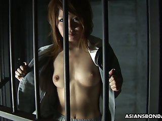 Asian prisoner Rio Haruna gives a acquiescent blowjob not far from one weird clothes-horse