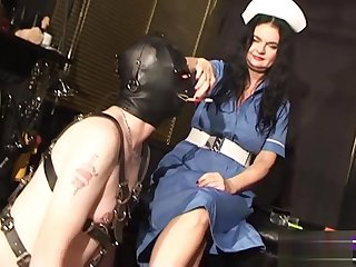 Dominatrix Dinah with TV and smoking slave