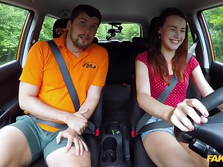 Foxy redhead Charlie Red offers her pussy to pass the drivers test